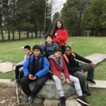 Group of students sitting on rock