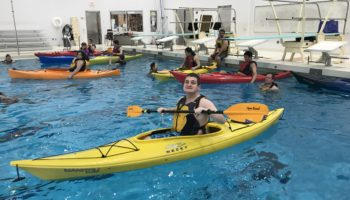 Smiling through kayaking