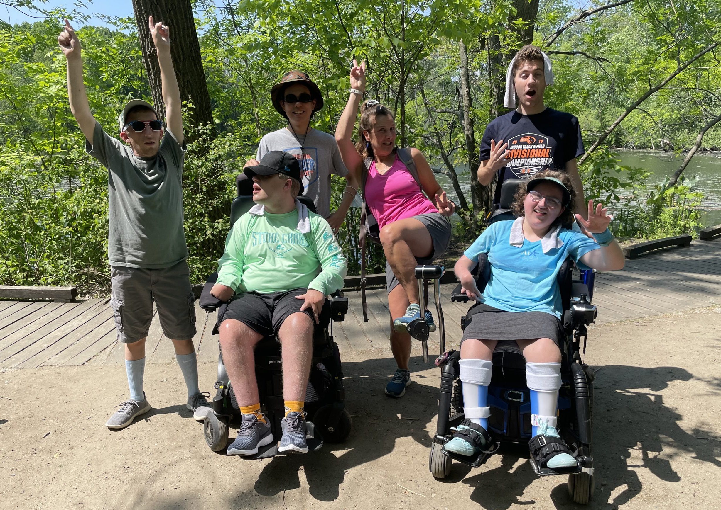 Group of hikers with varying abilities doing wacky poses